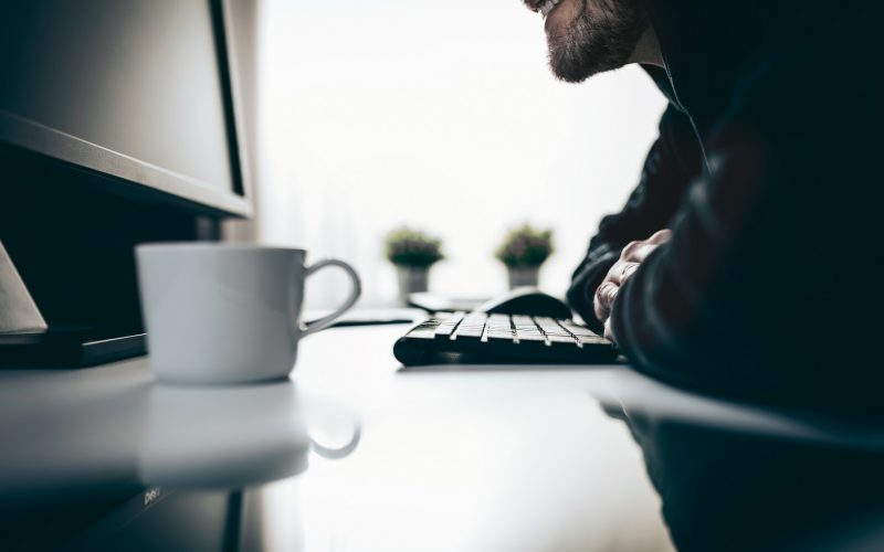 Computer hacker stealing valuable information from web