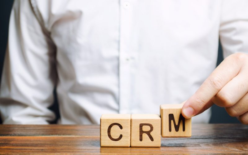 wooden-blocks-with-the-word-crm-customer-relationship-management-and-businessman-automation_t20_AVkJ0m